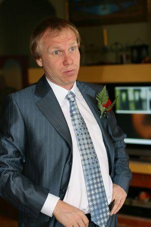 lapel: Portrait surprised men with a rose on a lapel of a jacket