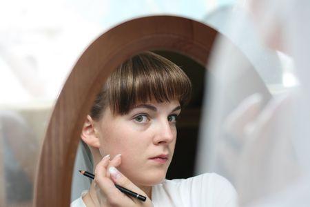 renders: The bride renders a make-up before wedding Stock Photo