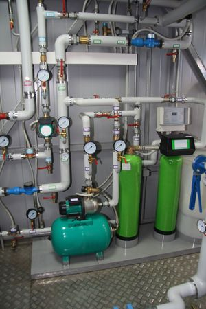 kelvin: Pumps, pipelines and devices in an interior of modern boiler-house