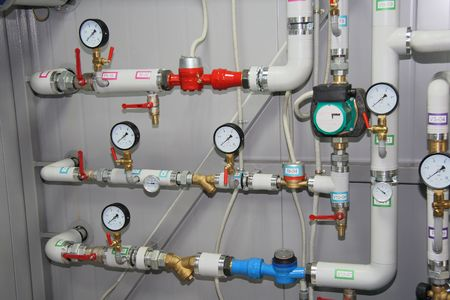 Pumps, pipelines and devices in an interior of modern boiler-house