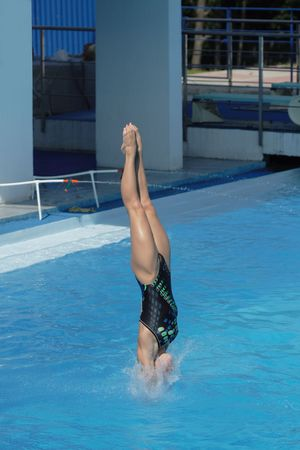 harmonous: Competitions on jumps in water. A beautiful jump of the harmonous girl
