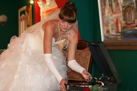 includes: The bride includes an old record player