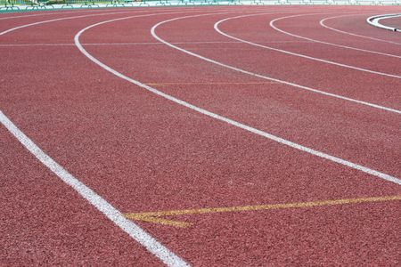 Racetrack in stadium with an artificial covering