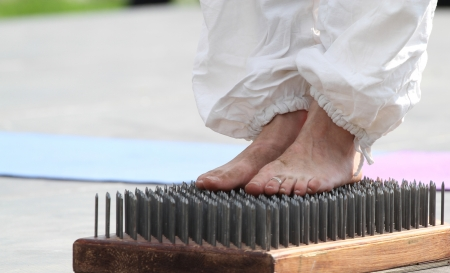 barefooted: Barefooted foot of the girl on edges of nails Stock Photo