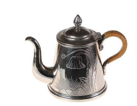 Beautiful teapot from cupronickel with the wattled handle and an ornament