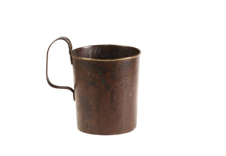 Ancient old bronze mug with the handle  Isolated