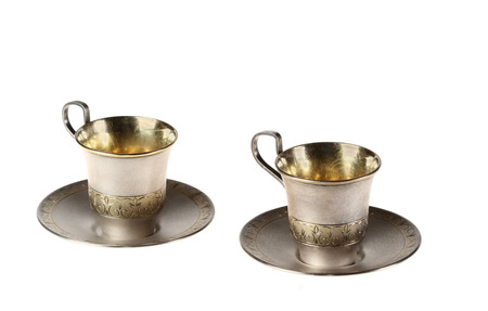 Two small cups coffee with saucers  Gold covering  Isolated Stock Photo
