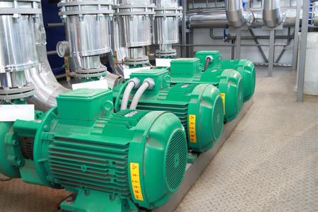 Group of four powerful pumps in a modern boiler-house