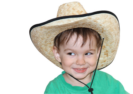 crafty: The boy in a hat with a crafty smile. Isolated.