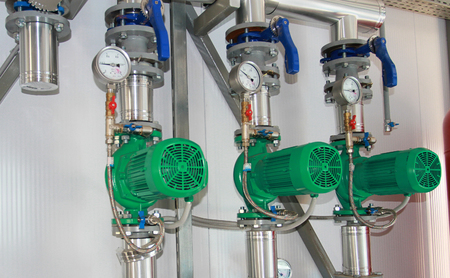 Group of three pumps in vertical position