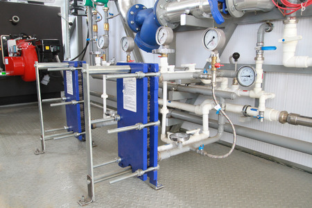 Two modern heat exchangers established in a boiler-house Stock Photo