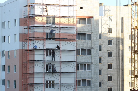 Workers in construction are exterior walls
