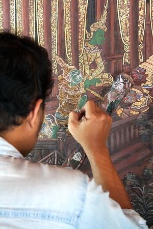 craftman: Bangkok,Thailand, November 14 2010 : Repairing of Ramayana Epic painting on wall at Prakeaw temple