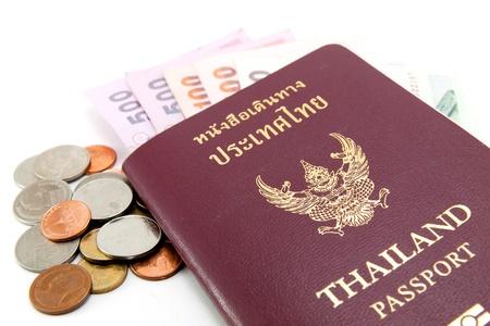 Thailand passport and Thai money on white background photo