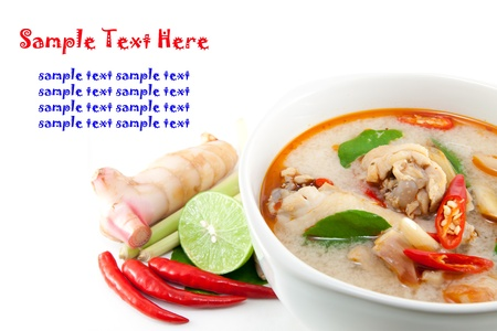 chicken wing tom yum in bowl (Thai food) and herb ingredient on white background photo