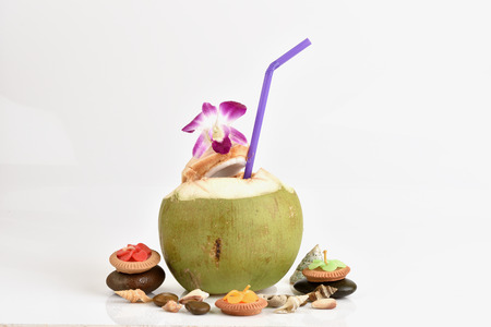 isotonic: Coconut - Tropical green coconuts opened for the drinking water with straws.