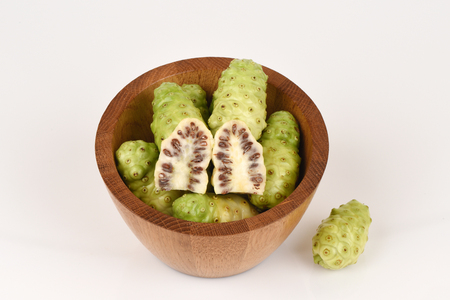 Noni (Morinda citrifolia L.) fruits and herbs with medicinal properties.