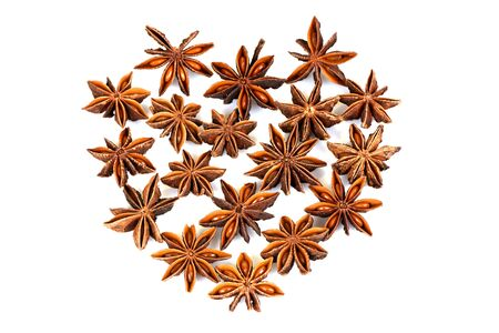 Chinese star anise, Star anise, fruits paste on a white background.โป๊ย�ั๊� Chinese star anise, Star anise, fruits have medicinal properties and on a white background. (Arranged in a heart shape)
