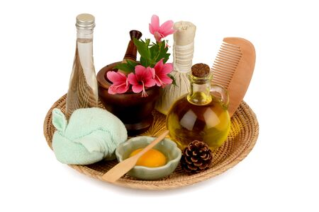 Soak hair with hibiscus flowers, egg yolks and oil for healthy hair. It has medicinal properties and on a white background.