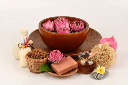 Face mask and soap made with Gaysorn extract, lotus flower and honey has medicinal properties and on a white background.