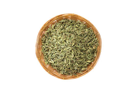 Dried fennel in a bamboo basket isolated on white