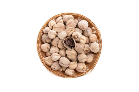 Dried Siam cardamom in a bamboo basket isolated on white Stock Photo
