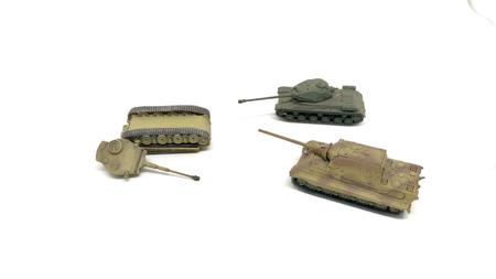 battle of toy tanks isolated on white background Stock Photo