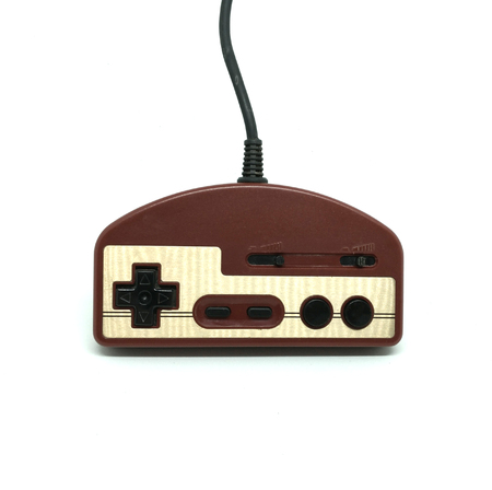 90s: Old dirt video game controller isolated on white background. Classic toy.