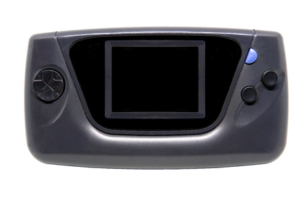 Old and dirty Portable Game Console isolated on white background with clipping path. Stock Photo