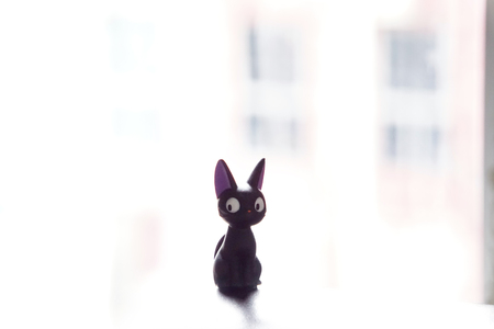 Bangkok, Thailand : August 14th,2017. Plastic figure toy. Jiji Cat from Studio Ghibli's animation movie Kiki's Delivery Service.