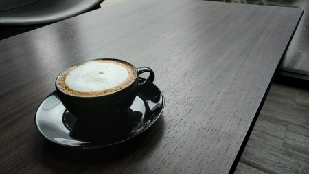 coffee latte on wooden table. Stock Photo