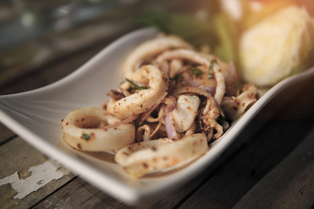 Hot and Spicy squid salad. Thai sea food. Stock Photo