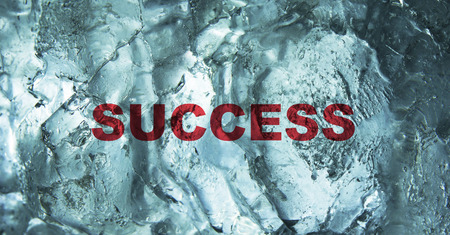 The Success word behind the ice wall background. Bussiness concept.