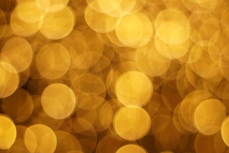The golden bokeh blurred abstract pattern background. Zdjęcie Seryjne