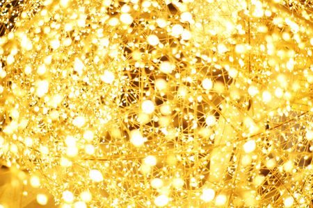 The golden LED light bokeh blurred abstract pattern background. 스톡 콘텐츠