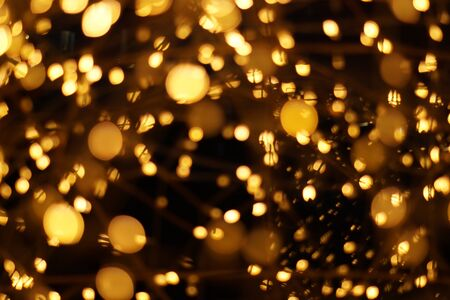 The golden bokeh blurred abstract pattern background. 스톡 콘텐츠