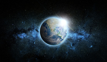 Planet Earth with sunrise on space background.