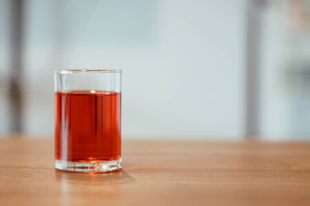 A glass of sweet red soda on the table. Zdjęcie Seryjne - 128014752