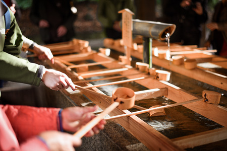 rinse: People rinse hands and mouth before entering the shrine at Meiji Jingu Shrine