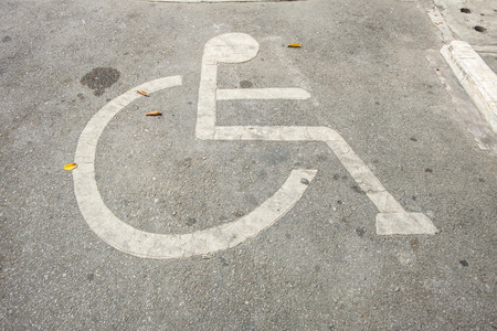 needy: The Reserved car park for handicapped on cement floor background