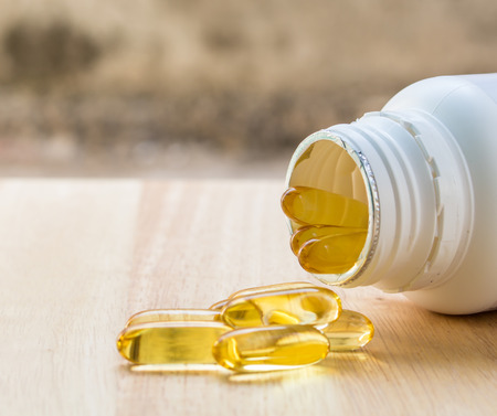 evening primrose: Evening primrose oil capsule on wood,supplementary food