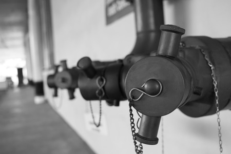 PUMPER: contact pont fire hose of building,black and white concept