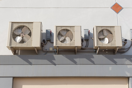 coolant: Air conditioning system assembled on side of a building.