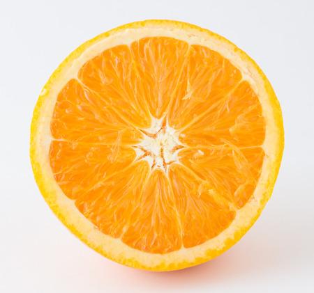 nontoxic: half nontoxic orange on white background Stock Photo