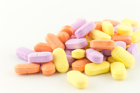 the antibiotic: colorful antibiotic tablets on white Stock Photo