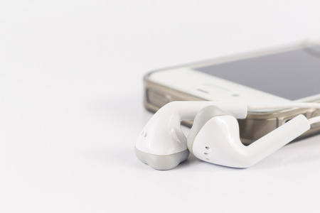 mobile headsets: close up phone headsets with mobile phone Foto de archivo