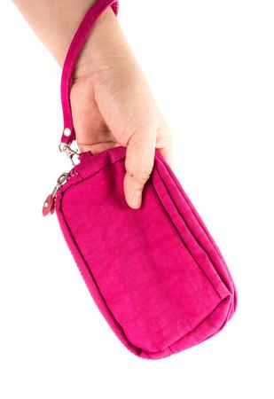 money pocket: dinero de bolsillo de color rosa en la mano de la mujer en blanco Foto de archivo