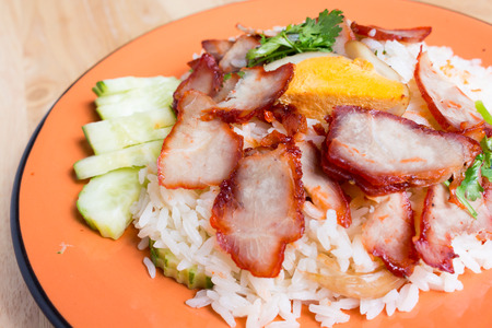 barbecued: Barbecued red pork in sauce with rice.