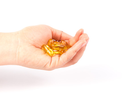 evening primrose oil: Evening primrose oil capsule in a hand,supplementary food. Stock Photo