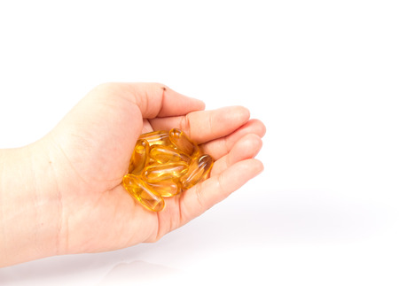 primrose oil: Evening primrose oil capsule in a hand,supplementary food. Stock Photo